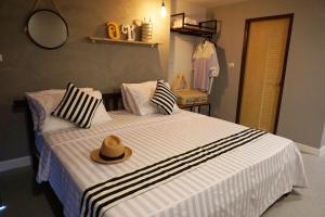 曼谷漢莎府住宿加早餐旅館房間的床