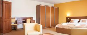 Posteľ alebo postele v izbe v ubytovaní Penzión Begálka