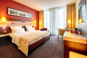 A bed or beds in a room at Leonardo Royal Hotel Munich