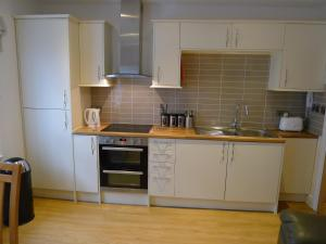 A kitchen or kitchenette at Church Court Apartments