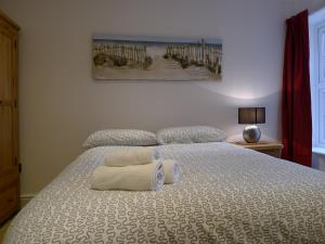 A bed or beds in a room at Church Court Apartments
