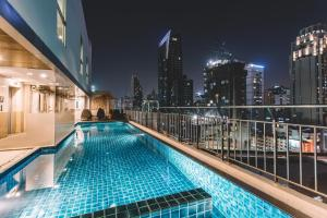 The swimming pool at or near Adelphi Suites Bangkok