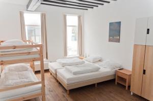 Een bed of bedden in een kamer bij City Hostel Vlissingen