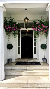 The facade or entrance of Anglesey Hotel