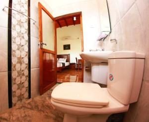 A bathroom at Grand Residence