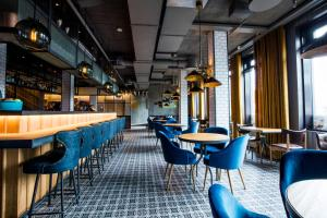 A restaurant or other place to eat at Canopy by Hilton Reykjavik City Centre
