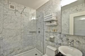 A bathroom at Dylan Hotel NYC