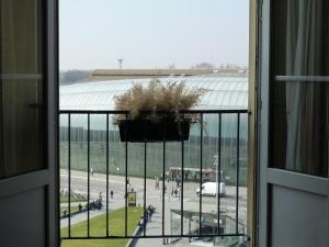 Een balkon of terras bij Le Grand Hotel