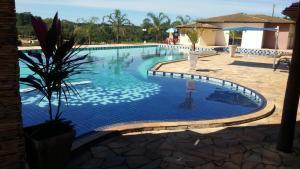 A piscina localizada em Canto Verde Hotel ou nos arredores