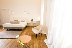 Un ou plusieurs lits dans un hébergement de l'établissement L'Hôtel Particulier Beziers