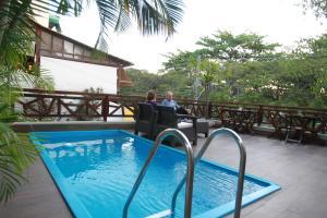 The swimming pool at or near Hangar Rio Hostel