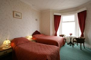 A bed or beds in a room at The Clifton