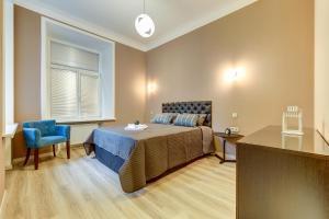 Кровать или кровати в номере Home SPb apartments