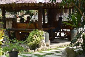 A porch or other outdoor area at Junia Guesthouse Bukit Lawang