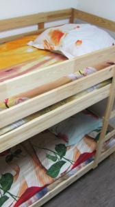 Кровать или кровати в номере Хостел Travel