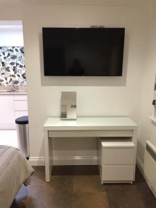 A television and/or entertainment center at Mildmay Road Apartments