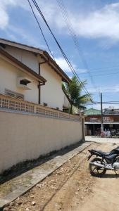 Uma varanda ou outra área externa em Casa Perequê-Açu