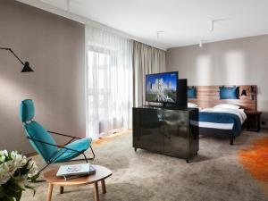 A television and/or entertainment center at Hotel Sadova