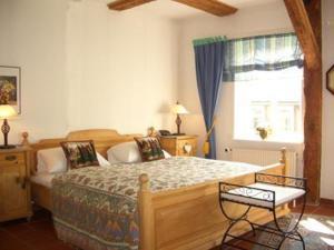 Кровать или кровати в номере Hotel am Glockenturm