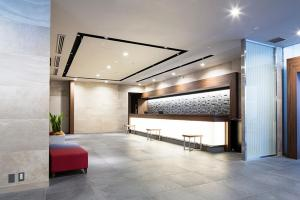 The lobby or reception area at HOTEL MYSTAYS Shin Osaka Conference Center