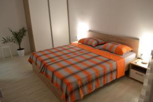 Posteľ alebo postele v izbe v ubytovaní Lazarus Apartment