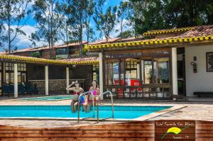 The swimming pool at or near Hotel Fazenda Ceu Aberto