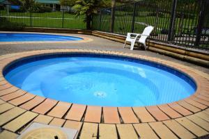 The swimming pool at or near Waitomo TOP 10 Holiday Park