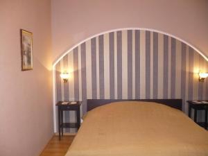 Кровать или кровати в номере Отель «На Ленинском »