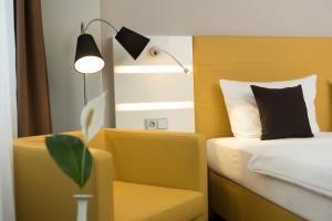 A seating area at Best Western Hotel Braunschweig Seminarius