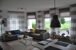 Een zitgedeelte bij Appartement De Boppeslach