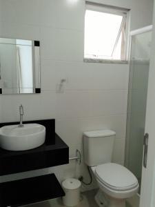 Um banheiro em Mediterraneo Home Club