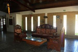 Uma área de estar em Mar & Sol Praia Hotel