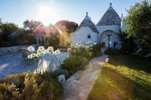 A garden outside Leonardo Trulli Resort
