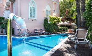 The swimming pool at or near Hotel Milton Rimini