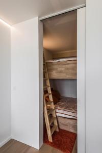 Un ou plusieurs lits superposés dans un hébergement de l'établissement Studio Zeezicht