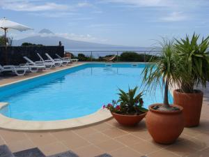 The swimming pool at or near Cantinho das Buganvilias AT****