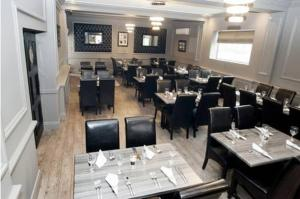 A restaurant or other place to eat at Grand St Leger Hotel