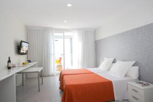 Letto o letti in una camera di Apartamentos Mix Bahia Real