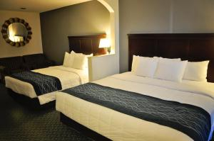 A bed or beds in a room at Dunes Express Inn and Suites