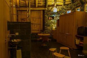 Un restaurante o sitio para comer en Palloza Baltasar