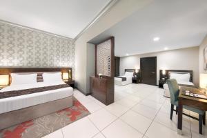 Ein Zimmer in der Unterkunft Gateway Hotel