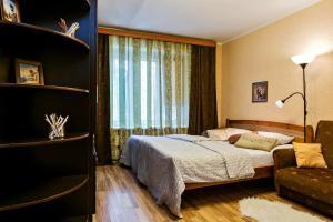 Кровать или кровати в номере GoodSleep Dnepropetrovskaya5