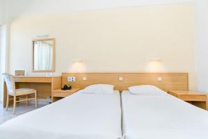Posteľ alebo postele v izbe v ubytovaní Hotel Riviera