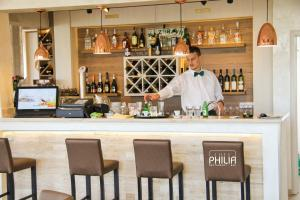The lounge or bar area at Philia Hotel