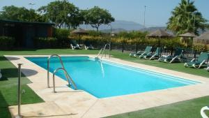 The swimming pool at or near Posadas de España Malaga