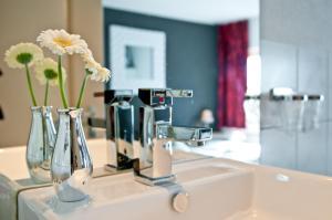 Een badkamer bij Hotel Berg en Bos