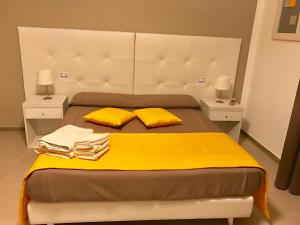 A bed or beds in a room at B&B Le Residenze
