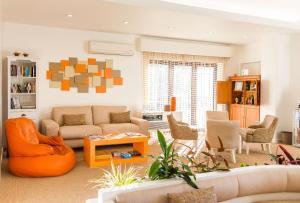 A seating area at Casa do Outeiro - Arts & Crafts Boutique Hotel