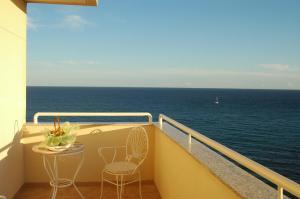 A balcony or terrace at Hotel Masa International
