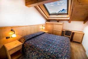Letto o letti in una camera di Hotel Giardino